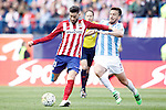 Atletico de Madrid's Yannick Carrasco (l) and Malaga CF's Ignacio Camacho during La Liga match. April 23,2016. (ALTERPHOTOS/Acero)