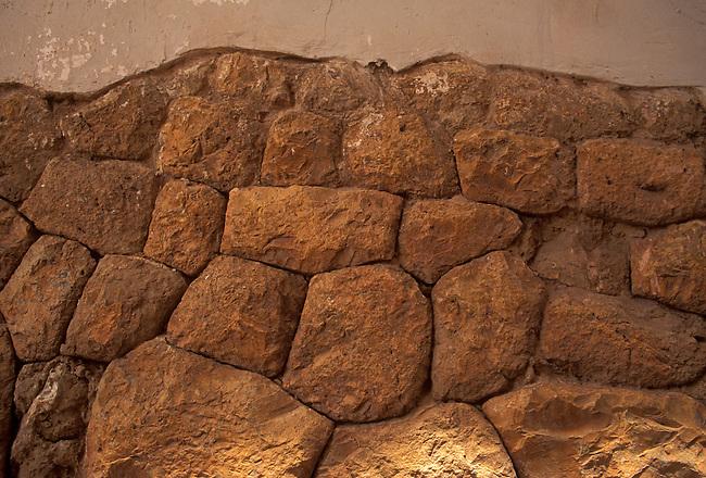 Inca stones at base of wall along narrow walkway, Cuzco, Peru, South America