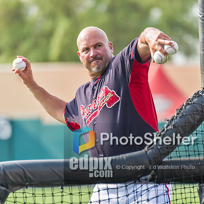 19 March 2015: Atlanta Braves Manager Fredi Gonzalez tosses batting practice prior to a Spring Training game against the Miami Marlins at Champion Stadium in the ESPN Wide World of Sports Complex in Kissimmee, Florida. The Braves defeated the Marlins 6-3 in Grapefruit League play. Mandatory Credit: Ed Wolfstein Photo *** RAW (NEF) Image File Available ***