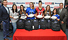 Hank Winnicki, left, and Gregg Sarra of Newsday pose for a picture with six varsity female football players from Long Island at Modell's Sporting Goods in Farmingdale on Monday, Nov. 21, 2017. Appearing with Winnicki and Sarra are, from left, Cayleigh Kunnmann of Bay Shore, Alexis Saladino of Newfield, Amber Seifts of Centereach, Hannah Martin of Patchogue-Medford, Megan Benzing of Mepham and Mia Advocate of Calhoun.