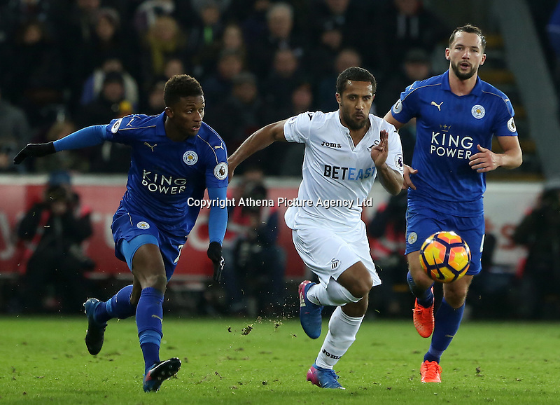 Wayne Routledge of Swansea City is closely marked by Demarai Gray and Danny Drinkwater of Leicester City during the Premier League match between Swansea City and Leicester City at The Liberty Stadium, Swansea, Wales, UK. Sunday 12 February 2017