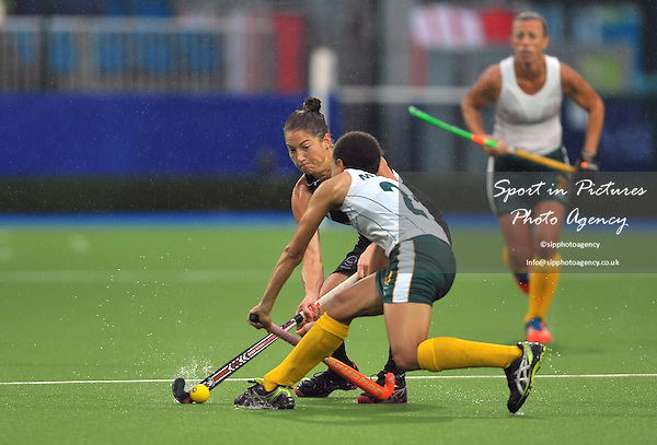 Krystal Forgesson (NZL) and Lenise Marais (RSA). South Africa (RSA) v New Zealand (NZL). Womens bronze medal match. Hockey. PHOTO: Mandatory by-line: Garry Bowden/SIPPA/Pinnacle - Tel: +44(0)1363 881025 - Mobile:0797 1270 681 - VAT Reg No: 183700120 - 020814 - Glasgow 2014 Commonwealth Games - Glasgow national hockey centre, Glasgow, Scotland, UK