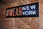 #WearNewYork sign displayed on wall during the inaugural Wear New York Fashion Week presentation at 393 Broadway on June 27, 2013.