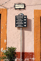 Direction signs in the 19th century mining town of Mineral de Pozos, Guanajuato, Mexico.