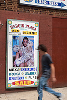 """A man walks by an English-Russian advertisement board in the New York City borough of Brooklyn, NY, Monday August 1, 2011. Nicknamed """"Little Odessa""""  due to many of its residents having come from Odessa, a city of Ukraine, Brighton Beach is an oceanside neighborhood in the New York City borough of Brooklyn"""