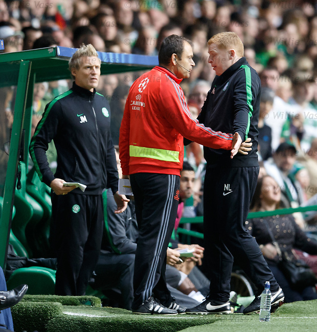 Neil Lennon complains to the officials as Scott Brown trudges up the tunnel after his red card
