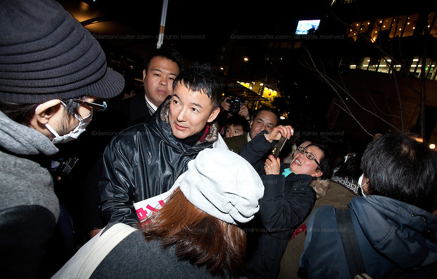 Actor, Taro Yamamoto greats people in the crowd as he campaigns for election as representative of Tokyo's Suginami Ward in the upcoming election. Ogikubo, Tokyo, Japan. Friday December 14th 2012