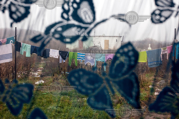 Washing, seen through the window of an apartment, hanging on a line in the Roma settlement located in 'Budulovskej Street'.