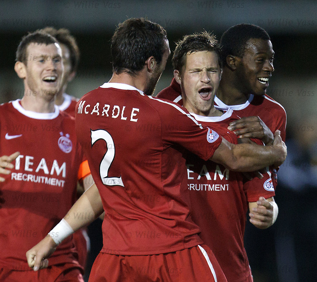 Chris Maguire celebrates as he blasts in a 25 yard goal for Aberdeen