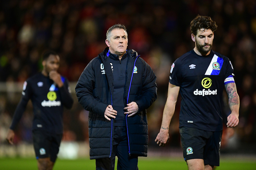 Blackburn Rovers manager Owen Coyle, centre, and Blackburn Rovers&rsquo; Charlie Mulgrew walk off the pitch at the end of the game<br /> <br /> Photographer Chris Vaughan/CameraSport<br /> <br /> The EFL Sky Bet Championship - Barnsley v Blackburn Rovers - Monday 26th December 2016 - Oakwell Stadium - Barnsley<br /> <br /> World Copyright &copy; 2016 CameraSport. All rights reserved. 43 Linden Ave. Countesthorpe. Leicester. England. LE8 5PG - Tel: +44 (0) 116 277 4147 - admin@camerasport.com - www.camerasport.com