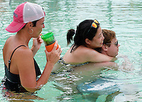 Jared's sister-in-law, Christa, and cousin and wife, Austin Stuart & Francisca Susanto, hang out in the pool on Wednesday, two days before the Punta Cana wedding