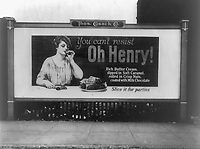 A billboard advertising Oh Henry! candy bars circa 1923. Because of a sluggish demand for chocolate Nestlé is considering selling its U.S. chocolate business. of which Oh Henry! is one of their brands. (Library of Congress)