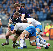 17th March 2018, Stadio Olimpico, Rome, Italy; NatWest Six Nations rugby, Italy versus Scotland; John Barclay of Scotland is challenged by Dean Budd and Carlo Canna of Italy