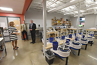 NWA Democrat-Gazette/FLIP PUTTHOFF <br /> ACADEMY CELEBRATION<br /> Arkansas Arts Academy CEO Mary Ley gives a tour of the school's pottery lab on Thursday March 14 2019 during a dedication marking completion of the Arkansas Arts Academy high school campus. The campus is at Fifth and Poplar streets in Rogers. Students gave tours of the building, including a culinary arts kitchen and classrooms, after the ribbon cutting. The campus went through a $22 million renovation that increased the square footage from 56,000 to 99,000 square feet. The growth allows increased enrollment and course offerings.