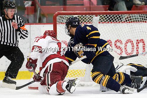 Daniel Moriarty (Harvard - 11), Loren Barron (Quinnipiac - 4) - The Harvard University Crimson and Quinnipiac University Bobcats played to a 2-2 tie on Saturday, November 5, 2011, at Bright Hockey Center in Cambridge, Massachusetts.