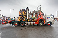 Pictured: The Banksy is transported on a flat bed lorry through Dyffryn Road and into Commercial Street. Wednesday 29 May 2019<br /> Re: Contractors are working to move Banksy's Season Greeting, now owned by John Brandler, which appeared on a garage wall in Port Talbot, to a new location in the same town in south Wales, UK.