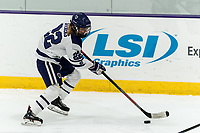 WORCESTER, MA - FEBRUARY 08: Sarah Stevens #22 of Holy Cross brings the puck forward during a game between Boston University and College of the Holy Cross at Hart Center Rink on February 08, 2020 in Worcester, Massachusetts.