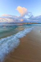 A gentle wave rolls upon the shore at Po'ipu Beach Park, one of Kaua'i's favorite beach parks.