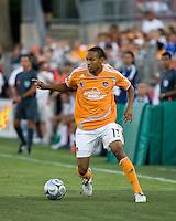 Houston Dynamo midfielder Ricardo Clark (13) dribbles the ball.  Houston Dynamo defeated  New York Red Bulls 1-0 at Robertson Stadium in Houston, TX on May 31, 2008.