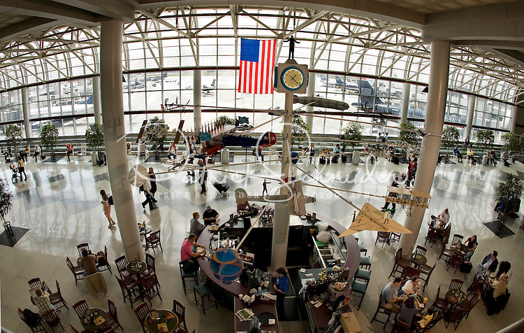 Travelers pass through the main terminal of Charlotte-Douglas International Airport. ..Charlotte-Douglas International Airport, one of US Airways' largest hubs, serves 10 major airlines, including Air Canada, Air Tran, American, Continental, Delta, JetBlue, Lufthansa, Northwest and United. The airport is the nation?s 10th largest in terms of total operations, the 18th largest in terms of total passengers and the 37th largest in terms of cargo. Charlotte-Douglas serves 640 daily flights, including direct flights to 120 cities. ..Photographer has series of images from Charlotte-Douglas International Airport, including aerials. ... PATRICK SCHNEIDER PHOTO.COM
