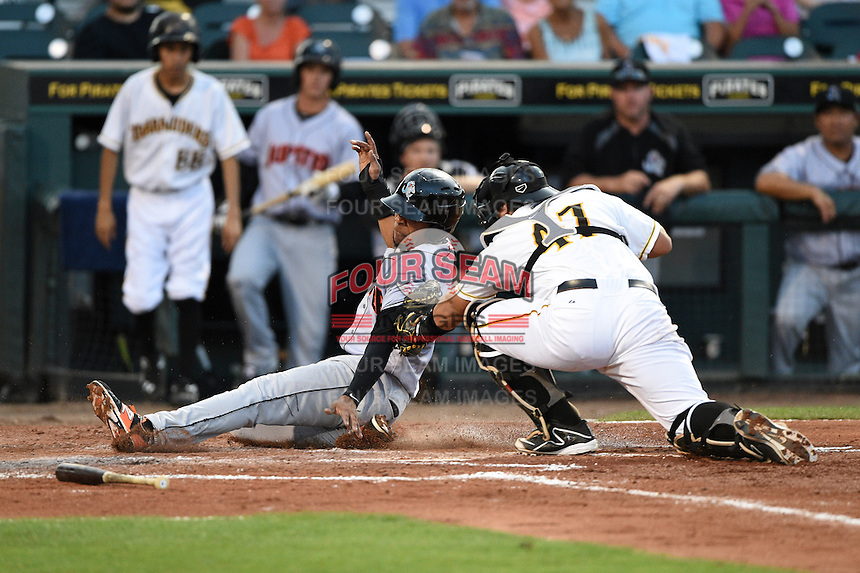 Jupiter Hammerheads second baseman Rehiner Cordova (1) is tagged out by catcher Jin-De Jhang (47) at home plate during a game against the Bradenton Marauders on April 17, 2015 at McKechnie Field in Bradenton, Florida.  Bradenton defeated Jupiter 11-6.  (Mike Janes/Four Seam Images)