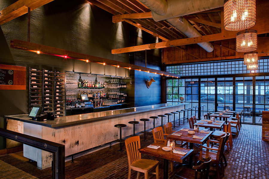 Industrial Modern are the words used to describe the new Bankers Hill Bar & Restaurant in San Diego. The interiors are rough, textured and visually interesting, comprised of blued steel, recycled factory components and other cultural artifacts and relics. Design by Paul Basile.