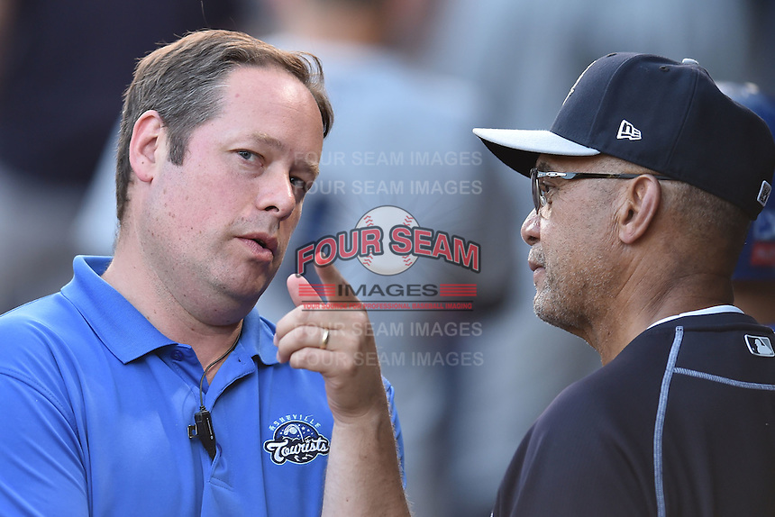 New York Yankees special assistant to the general manager Reggie Jackson with Asheville Tourists general manager Larry Hawkins after a game against the Asheville Tourists on June 13, 2015 in Asheville, North Carolina. The Tourists defeated the RiverDogs 10-6. (Tony Farlow/Four Seam Images)