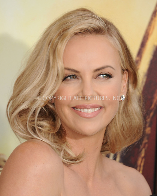 WWW.ACEPIXS.COM<br /> <br /> May 7 2015, LA<br /> <br /> Actress Charlize Theron arriving at the premiere  'Mad Max: Fury Road' at the TCL Chinese Theatre on May 7, 2015 in Hollywood, California. <br /> <br /> By Line: Peter West/ACE Pictures<br /> <br /> <br /> ACE Pictures, Inc.<br /> tel: 646 769 0430<br /> Email: info@acepixs.com<br /> www.acepixs.com