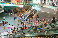 Commuters travel through the Fulton Center Transportation Hub on their way home, some of which will invariably not return to work the next day, getting an early start to the Memorial Day weekend on Thursday, May 26, 2016. Memorial Day is considered the unofficial start of summer.  (© Richard B. Levine)