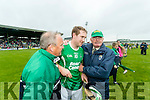 John Hennessy and Teddy O'Sullivan congratulate Padraig Boyle Ballyduff after scoring a free to draw the County Senior Hurling Final at Austin Stack Park on Sunday.