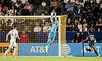 David Bingham #1 of the Los Angeles Galaxy leaps high for a ball
