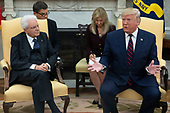 US President Donald J. Trump (R) delivers remarks during a meeting with President of Italy Sergio Mattarella (L) in the Oval Office of the White House in Washington, DC, USA, 16 October 2019. The leaders meet to discuss a wide variety of economic and security issues such as telecommunications security, the NATO alliance and the Turkish incursion into Syria.<br /> Credit: Michael Reynolds / CNP
