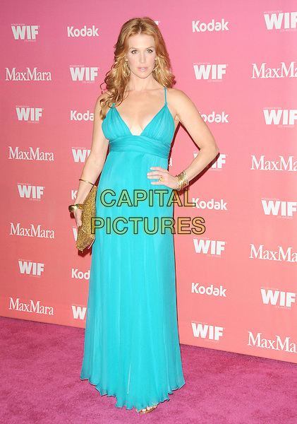 POPPY MONTGOMERY .at The Women in Film 2009 Crystal .and Lucy Awards held at The Hyatt Regency Century Plaza in Century City, California, USA, June 12th 2009                                                                     .full length blue turquoise long maxi dress hand on hip clutch bag gold bracelets .CAP/DVS.©Debbie VanStory/RockinExposures/Capital Pictures