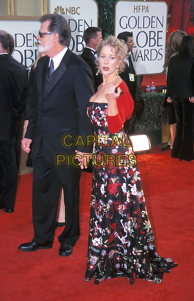 HELEN MIRREN.Golden Globe Awards.long floral print dress, strapless, flowery, pointing, red bolero jacket, cardigan.Ref: ND.www.capitalpictures.com.sales@capitalpictures.com.© Capital Pictures