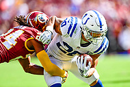 Landover, MD - September 16, 2018: Indianapolis Colts running back Jordan Wilkins (20) is tackled by Washington Redskins defensive back Josh Norman (24) during game between the Indianapolis Colts and the Washington Redskins at FedEx Field in Landover, MD. The Colts defeated the Redskins 21-9.(Photo by Phillip Peters/Media Images International)