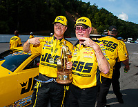 Jun 17, 2018; Bristol, TN, USA; NHRA pro stock driver Jeg Coughlin Jr (left) celebrates with father Jeg Coughlin Sr after winning the Thunder Valley Nationals at Bristol Dragway. Mandatory Credit: Mark J. Rebilas-USA TODAY Sports