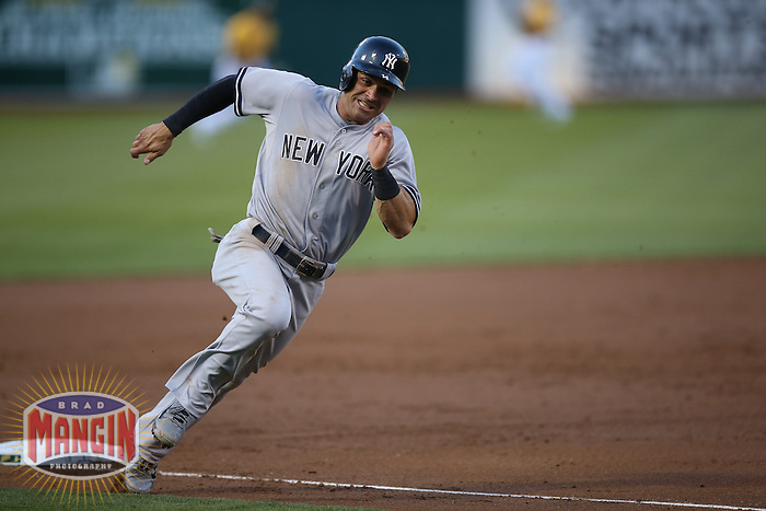 OAKLAND, CA - JUNE 13:  Brian Roberts #14 of the New York Yankees runs the bases against the Oakland Athletics during the game at O.co Coliseum on Friday, June 13, 2014 in Oakland, California. Photo by Brad Mangin