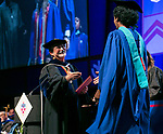 Guillermo Vásquez de Velasco, dean of the College of Liberal Arts and Social Sciences, congratulates students Sunday, June 11, 2017, during the DePaul University College of Science and Health and College of Liberal Arts and Social Sciences commencement ceremony at the Allstate Arena in Rosemont, IL. (DePaul University/Jamie Moncrief)