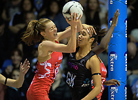 England's Helen Housby takes a pass under pressure from NZ goalkeep Phoenix Karaka during the Quad Series netball match between the New Zealand Silver Ferns and England Roses at Trusts Stadium, Auckland, New Zealand on Wednesday, 30 August 2017. Photo: Dave Lintott / lintottphoto.co.nz