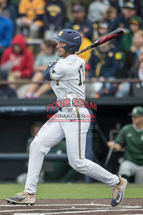 Michigan Wolverines third baseman Drew Lugbauer (17) follows through on his swing against the Michigan State Spartans on May 19, 2017 at Ray Fisher Stadium in Ann Arbor, Michigan. Michigan defeated Michigan State 11-6. (Andrew Woolley/Four Seam Images)