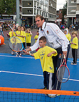 11-sept.-2013,Netherlands, Groningen,  Martini Plaza, Tennis, DavisCup Netherlands-Austria, Draw,   Street tennis on the market squire with Thiemo de Bakker(NED)<br /> Photo: Henk Koster