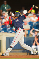 Michael Almanzar #25 of the Greenville Drive follows through on his swing against the Rome Braves at State Mutual Stadium July 24, 2010, in Rome, Georgia.  Photo by Brian Westerholt / Four Seam Images