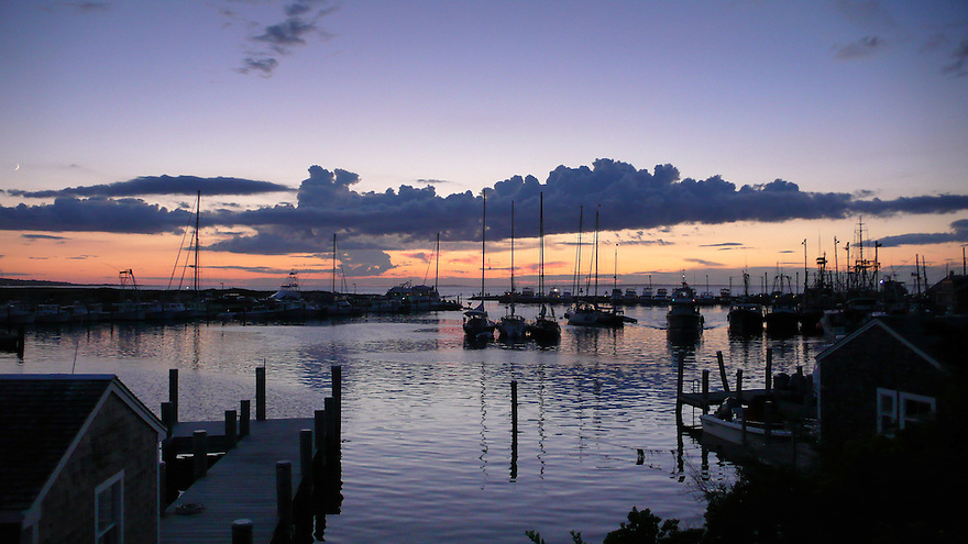 The sun sets over Menemsha Harbor on Martha's Vineyard.........