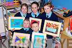 ARTISTS: Young artists from Ardfert National School on Wednesday getting their art work ready for Wednesday night's Art Exhibition in their school. Front l-r: Eimear O'Sullivan and Thomas Lyne. Back l-r: Zoe Newsome McDonnell, Aoife Leahy and Shelly Stack.