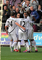 Pictured: Scott Sinclair of Swansea (2nd L) celebrating his goal from the penalty spot with team mates L-R Joe Allen, Leon Britton, Nathan Dyer and Leroy Lita. Saturday 17 September 2011<br /> Re: Premiership football Swansea City FC v West Bromwich Albion at the Liberty Stadium, south Wales.