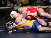 Brian Kampnich (III) and Garrett Morabito (IV) square off in the NY State Division Two finals at the 125 weight class during the NY State Wrestling Championship finals at Blue Cross Arena on March 9, 2009 in Rochester, New York.  (Copyright Mike Janes Photography)