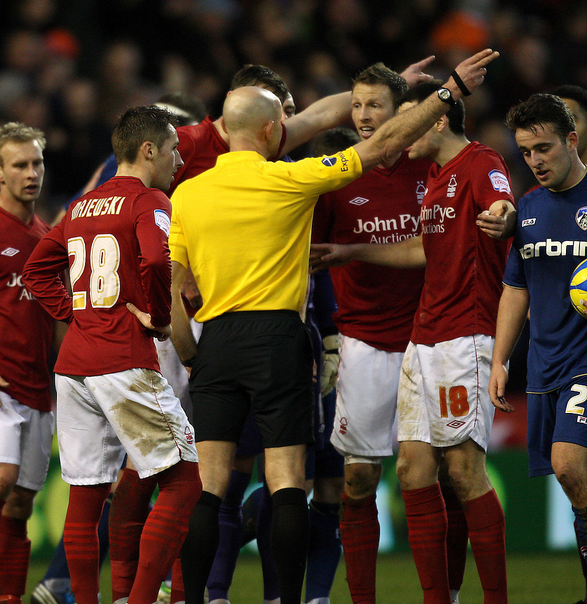 Nottingham Forest's Danny Collins is sent off by ref Roger East..Football - FA Challenge Cup Third Round - Nottingham Forest v Oldham Athletic - Saturday 5th January 2013 - The City Ground - Nottingham..