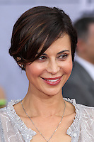"""HOLLYWOOD, LOS ANGELES, CA, USA - MARCH 11: Catherine Bell at the World Premiere Of Disney's """"Muppets Most Wanted"""" held at the El Capitan Theatre on March 11, 2014 in Hollywood, Los Angeles, California, United States. (Photo by Xavier Collin/Celebrity Monitor)"""