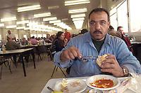 - Egyptian worker in yard refectory of new Milan fair at Rho-Pero....- operaio egiziano nella mensa del cantiere della nuova fiera di Milano a Rho-Pero