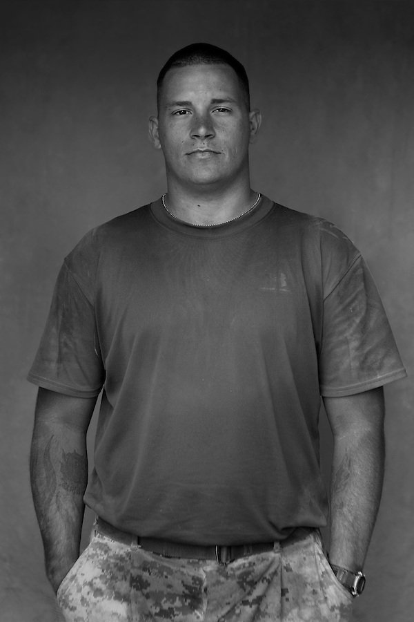 Sergeant Charles E. Brown, 25, Memphis, TN, Weapons Platoon, Kilo Company, 3rd Battalion 1st Marine Regiment. 1st Marine Division, United States Marine Corps at the company's firm base in Haditha, Iraq on Thursday, Oct. 12, 2005.
